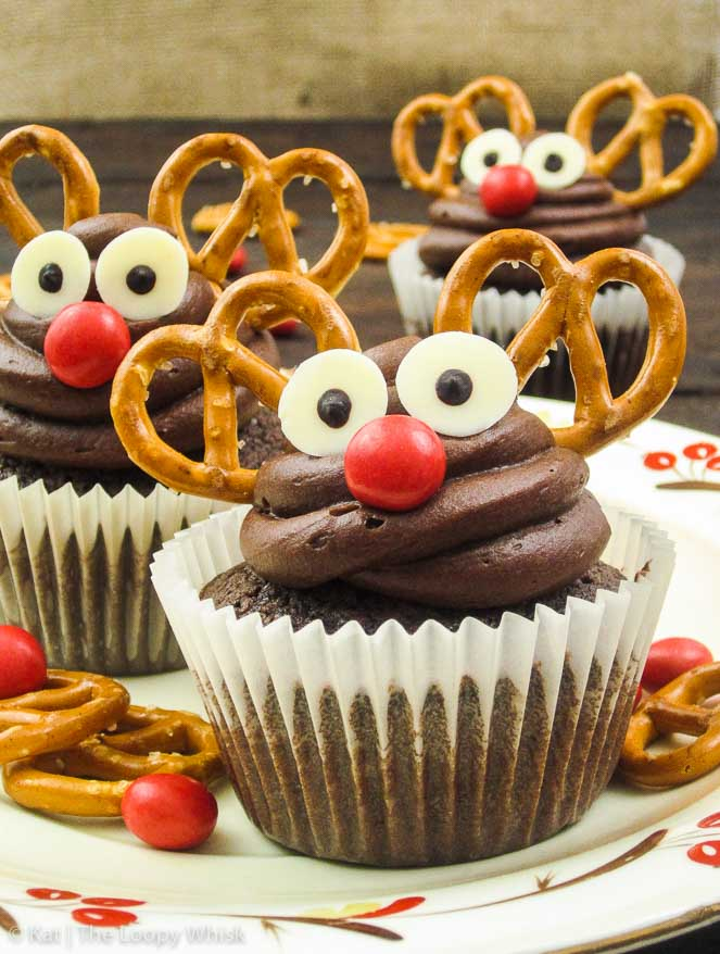 Rudolph Mexican Hot Chocolate Cupcakes - These adorable Christmas cupcakes are ridiculously easy and quick to make, and almost too pretty to eat. But they are also way too delicious not to, with their chocolatey taste and the spiciness from cinnamon, nutmeg and chilly powder.