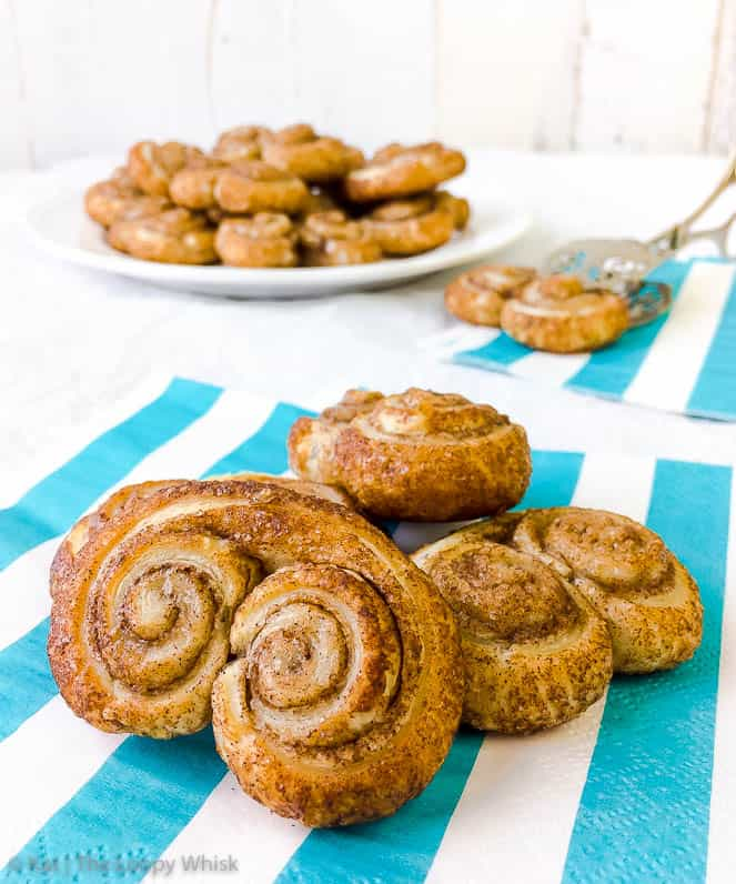 Cinnamon Sugar Puff Pastry Palmiers - 25 minutes and 4 ingredients is all you need to feast on these delightfully flaky, buttery cinnamon sugar puff pastry palmiers. Easy and quick to make, they are so out-of-this-world delicious, you will want to make them again and again!