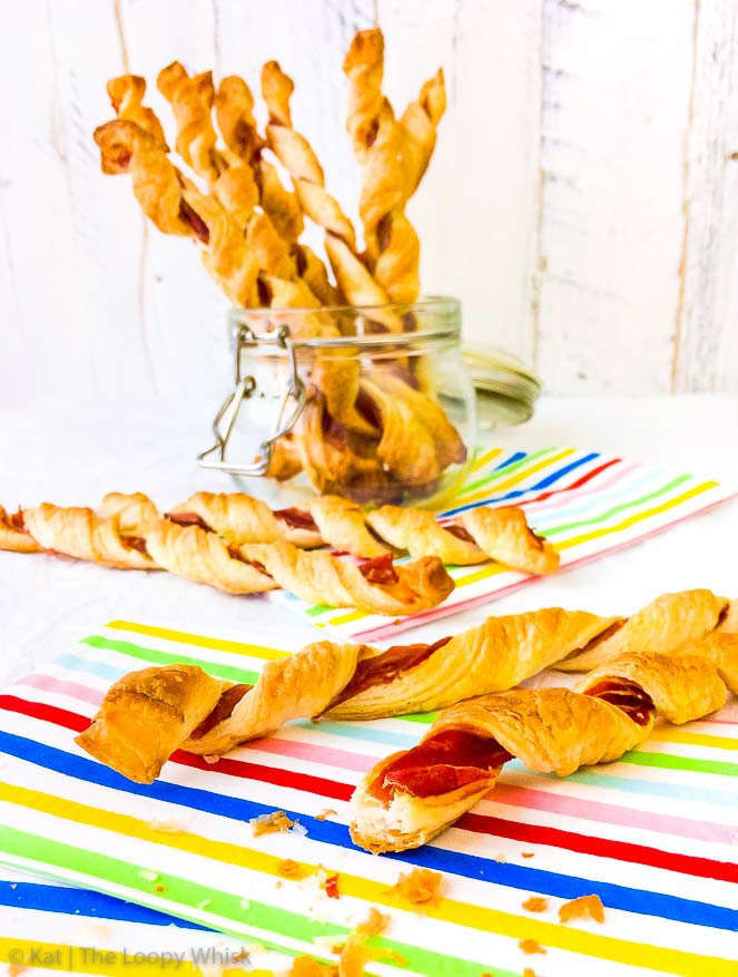 Savoury Prosciutto Puff Pastry Twists - These savoury prosciutto puff pastry twists make the ideal last-minute party nibble or appetiser, or simply a delicious snack. Buttery, flaky puff pastry teams up with salty prosciutto deliciousness in what just might be the easiest and quickest recipe to date.