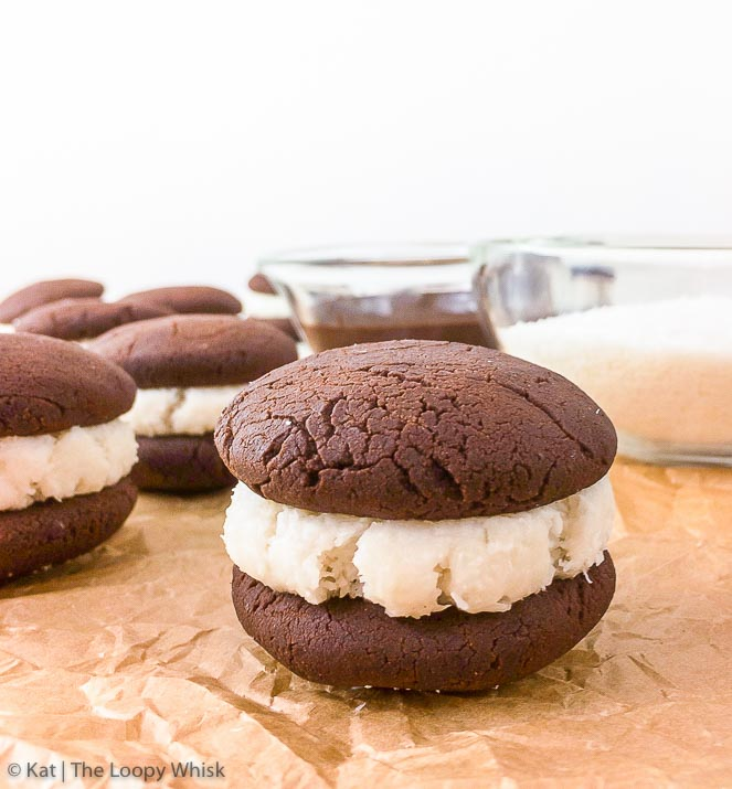 """Bounty"" Chocolate Coconut Sandwich Cookies - Prepare to be blown away by how absolutely scrumptious these ""Bounty"" chocolate coconut sandwich cookies are. Crumbly decadent chocolate cookies meet flavour-charged coconut filling in this gluten, dairy and refined sugar free treat, which features coconut in three different forms!"
