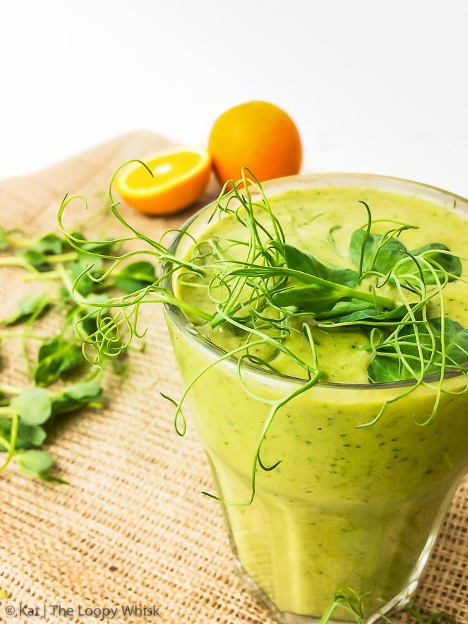 Spring Green Smoothie with Pea Shoots {gluten free, dairy free, sugar free, vegan, paleo} - Chock-full of healthy ingredients and almost-like-a-milkshake delicious, this spring green smoothie with pea shoots is a true nutritional powerhouse. It's almost overflowing with Vitamins A, B, C, E and K, and provides the perfect balance of healthy fats, protein and carbohydrates to be nicely filling. In addition, it's also gluten, dairy and sugar free, as well as vegan and paleo. Healthy has never tasted quite so good.