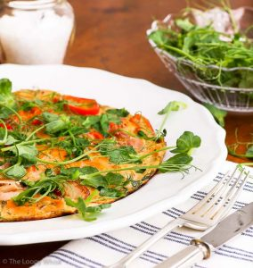 Vegetable Omelette with Pea Shoots {gluten free, dairy free, paleo, with vegetarian option} - Healthy, full of flavour, and done in virtually no time, this vegetable omelette with pea shoots is an ode to the awesomeness that are simple, fresh ingredients. Be it a savoury breakfast, a quick lunch, or even a filling snack – this vegetable omelette is the answer. The pea shoot microgreens give a special twist to this quick and healthy recipe, both in the omelette and sprinkled on top.