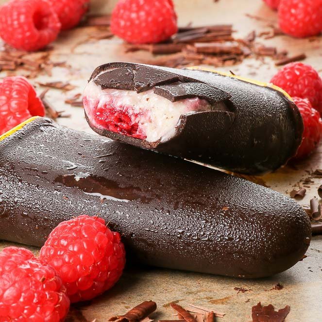 Healthy Chocolate & Raspberry Vegan Ice Cream Bars {gluten, dairy, egg, soy, peanut & ref. sugar free, vegan, paleo} - These vegan ice cream bars are super healthy and insanely delicious at the same time. The easy 2 for 1 recipe includes two ice cream flavours – chocolate and raspberry, both made even prettier with a fetching marbled effect. The chocolate shell is smooth and thick, and gives a satisfying snap when you bite into it. With little to no effort, you can make your own ice cream popsicles, which are way better than any shop-bought ones, in every single way.