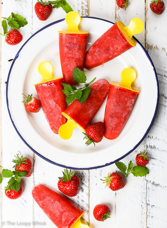 Healthy Strawberry Popsicles {gluten, dairy, egg, soy, nut & refined sugar free, vegan, paleo} - These strawberry popsicles are the perfect summer treat – refreshing, aromatic, sweet, and healthy. The strawberries give them the bright colour, as well as an abundance of vitamins. This easy popsicle recipe is gluten, dairy and refined sugar free, and it's bound to become a favourite this summer.