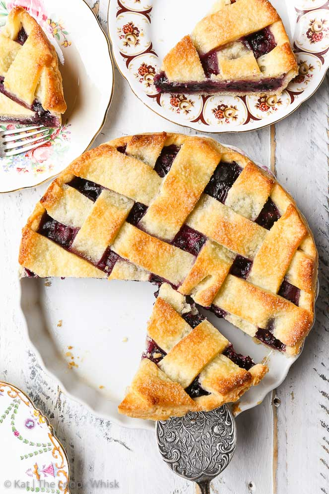 Gluten Free Blueberry Pie {gluten, nut & soy free, egg free option} - This gluten free blueberry pie will blow you away with just how delicious it is. Sweet summer blueberries meet crisp, flaky, buttery gluten free pie crust, which is really easy to make! The perfect gluten free dessert for your next family gathering, potluck or picnic (if you can part with it, that is).