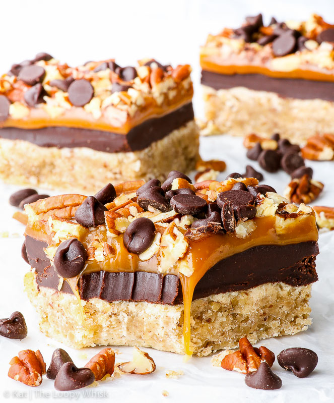 Salted Caramel and Chocolate Pecan Cookie Bars {gluten, peanut & soy free} - These gluten free salted caramel chocolate cookie bars will take your breath away and leave you craving more. There's four layers: pecan cookie, chocolate ganache, salted caramel and chopped pecans + chocolate chips. Perfect gluten free fall dessert.