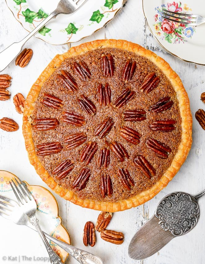Gluten & Refined Sugar Free Pecan Pie {gluten, soy, peanut & refined sugar free} - This gluten and refined sugar free pecan pie is a super delicious take on the traditional version. It's far less sugar-heavy, and has a rich, aromatic pecan frangipane as the filling. The gluten free pie crust is buttery and flaky, and completes what is an amazing gluten free fall dessert. #pecanpie #sugarfreepecanpie #sugarfree #glutenfree #glutenfreepiecrust