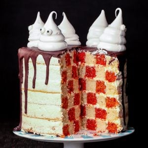 Spookalicious Checkerboard Gluten Free Halloween Ghost Cake {gluten, nut & soy free, dairy free option} - This gluten free Halloween cake is what happens when a checkerboard cake meets a spooky ghost cake. It's surprisingly easy to make, and it will certainly be the centrepiece at any Halloween party. The perfect gluten free Halloween treat, with a dairy free option! #glutenfree #halloween #cake