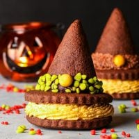 Gluten Free Witch Hat Cookie Sandwiches {gluten, nut & soy free} - These gluten free witch hat cookies are the perfect gluten free Halloween dessert. Easy to make gluten free chocolate cookies team up with a 3-ingredient pumpkin buttercream to make the most amazing Halloween cookies. #glutenfree #halloweenfood #halloweendesserts #halloweenrecipes