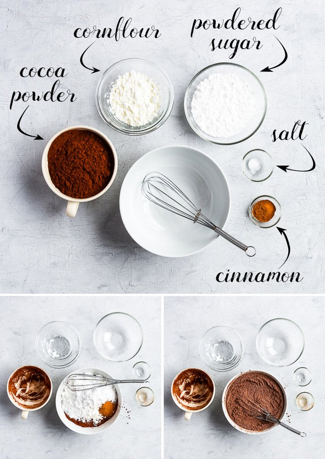 Bird's-eye view of the five ingredients of the homemade hot chocolate mix: cocoa powder, cornflour, powdered sugar, salt and cinnamon.