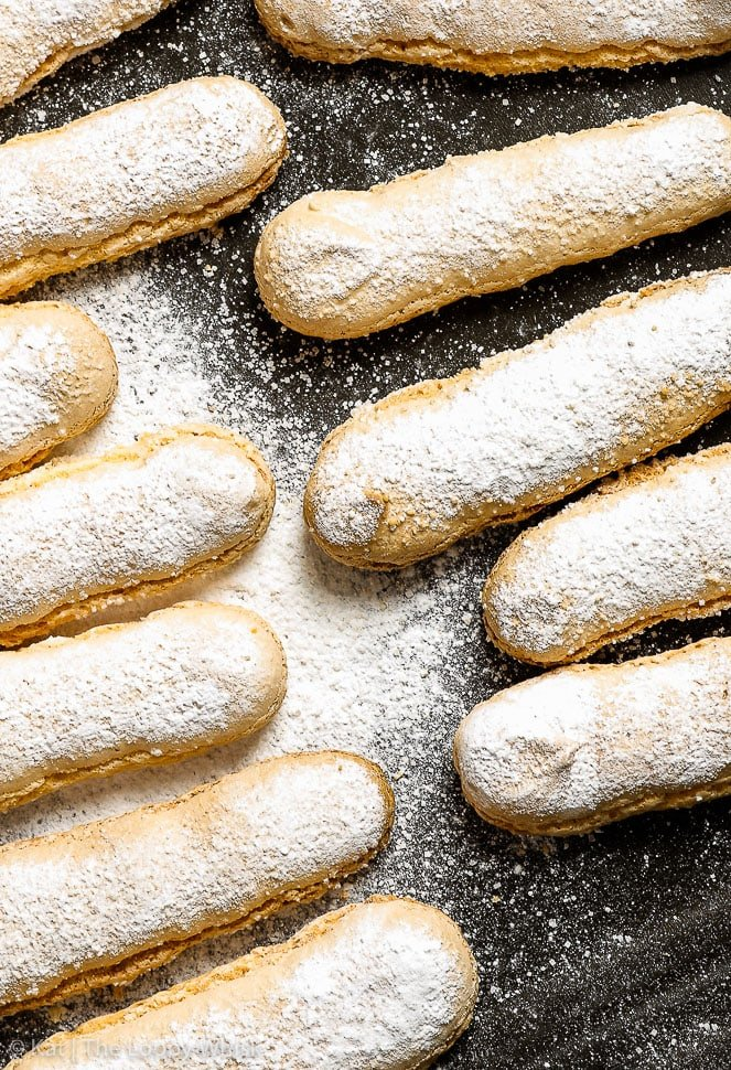 The perfect gluten free ladyfingers, a close-up overhead view on a black surface.