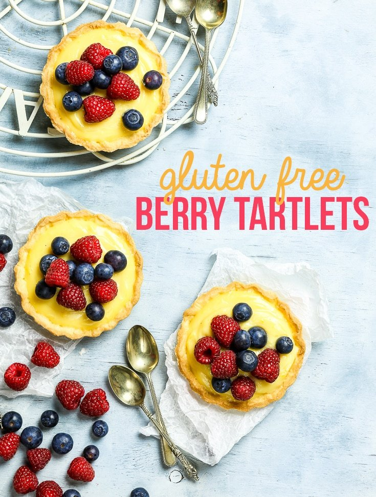 Gluten Free Berry Tartlets - These gluten free berry tartlets are everything bright and happy and summery. With a buttery sweet gluten free shortcrust pastry and a decadent lemon-flavoured cream filling, they are the perfect treat for any occasion. Super easy to make, these mini tarts are the perfect gluten free dessert! Gluten free recipe. Gluten free tart. Tart recipes. Dessert recipes. Creme patissiere tart. #glutenfree #recipe #food #dessert