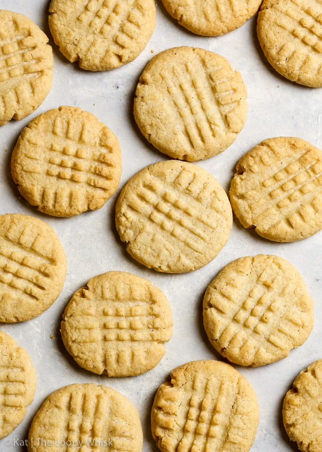 Overhead shot of gluten free peanut butter cookies on a greyish white background.
