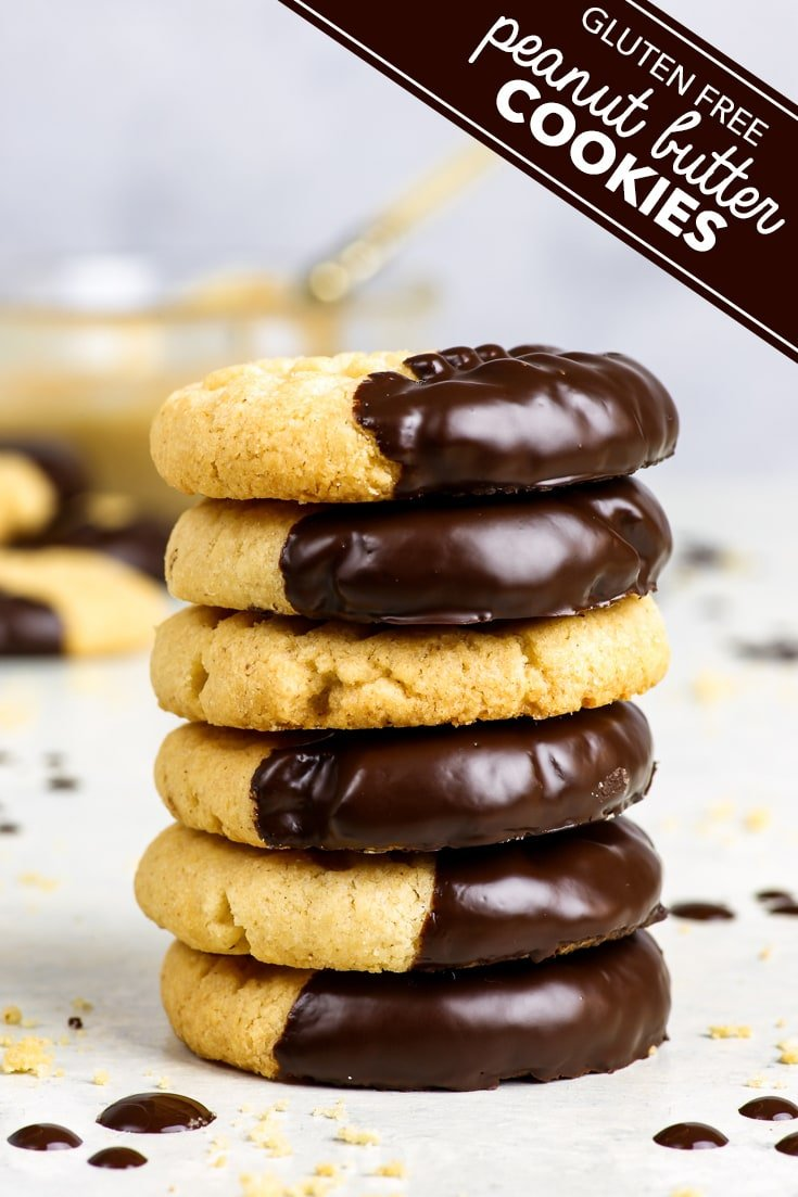 Chocolate Dipped Gluten Free Peanut Butter Cookies - 20 minutes, 6 ingredients and no baking skills required… to make these gluten free peanut butter cookies. These are 100% some of my all-time favourite cookies, and I'm sure you'll love them too! Make them extra special (and extra pretty) by dipping them into some dark chocolate. Gluten free cookies. Gluten free dessert. Easy cookie recipe. Classic peanut butter cookies. #glutenfre #recipe #food #cookies #dessert #peanutbutter