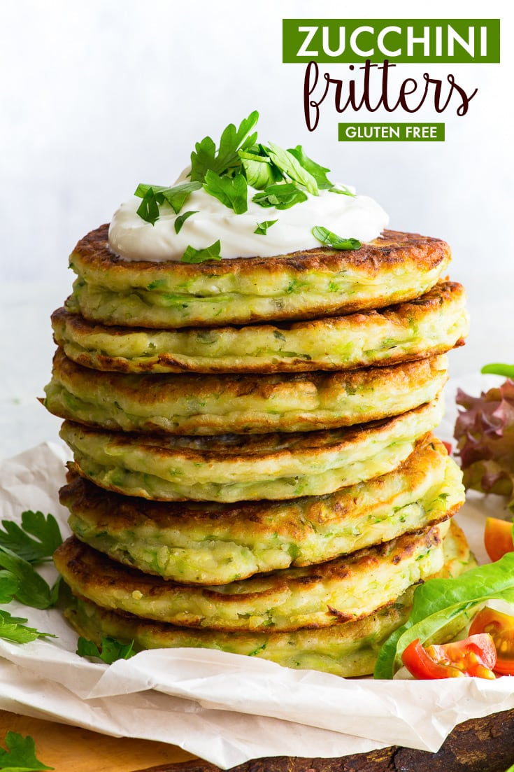 Zucchini Fritters (Gluten Free, Dairy Free Option) - Healthy, easy to make and absolutely delicious, these gluten free zucchini fritters make the perfect summer lunch! The addition of lemon zest and plenty of herbs make them wonderfully aromatic, and they can be made in less than half an hour. Summer recipes. Summer lunch ideas. Healthy lunch ideas. Healthy recipes. Zucchini recipes. Courgette recipes. #zucchini #fritters #summer #lunch #glutenfree #recipes
