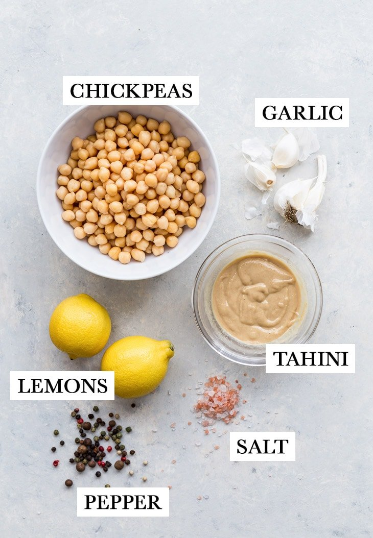 The ingredients required for the homemade hummus: chickpeas, garlic, tahini, lemons, salt and pepper.