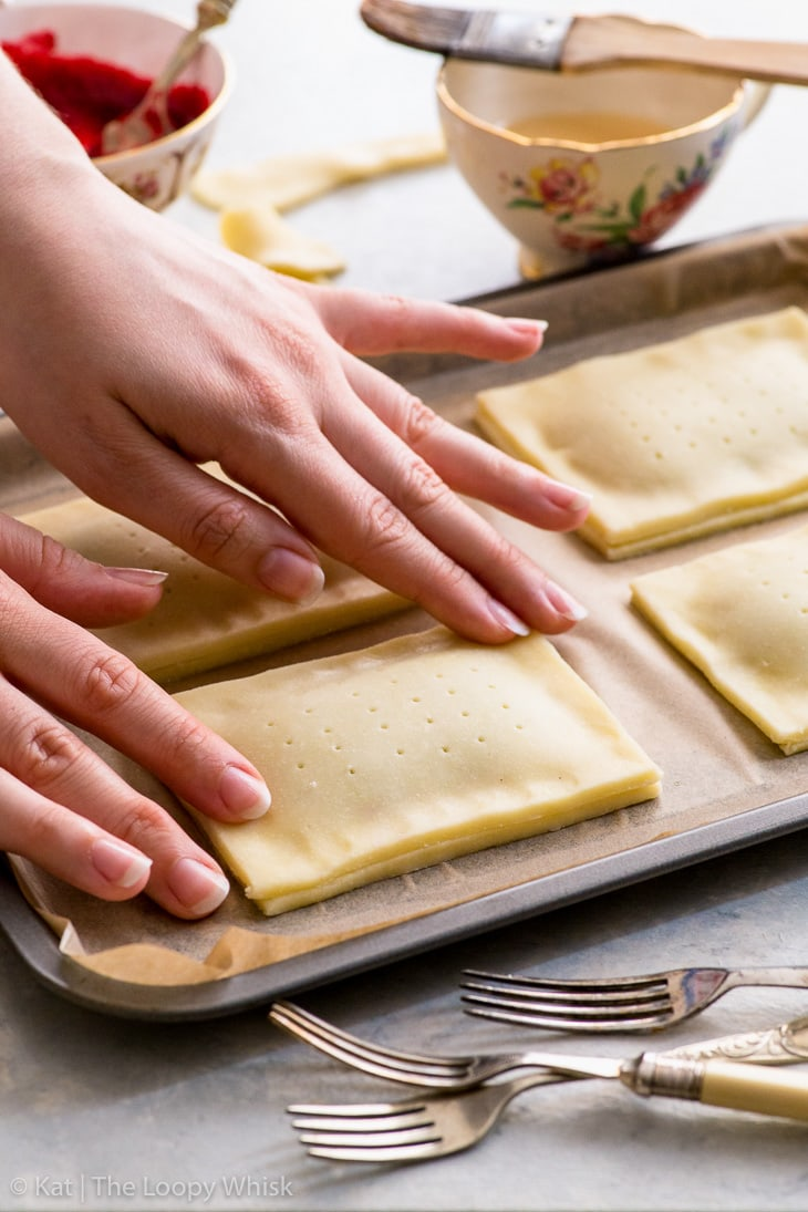 Process of making gluten free pop tarts: sealing the pop tart edges.