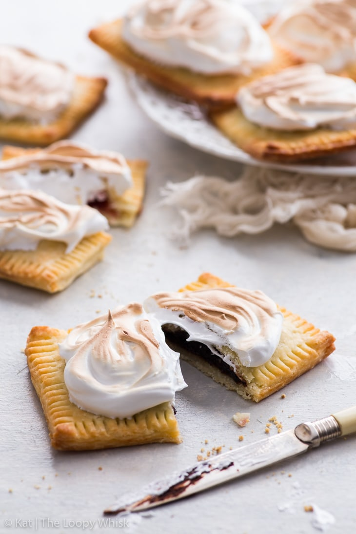 A s'mores pop tarts cut in half, with more pop tarts in the background.