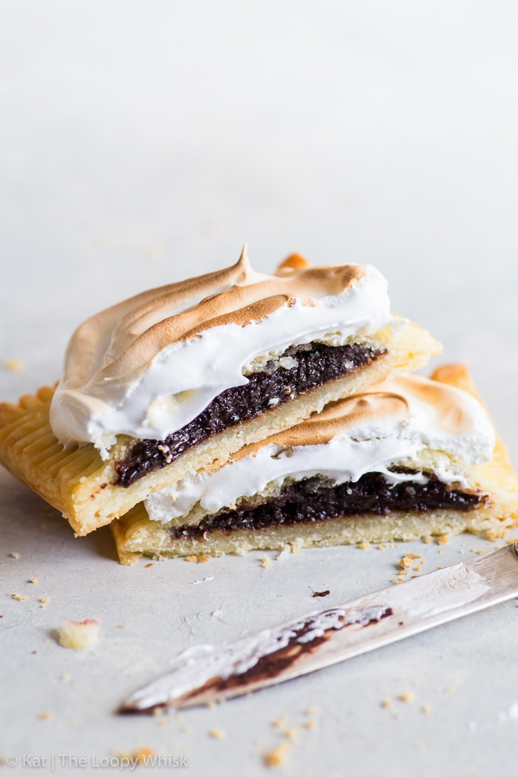 A s'mores pop tart cut in half with the fudgy chocolate filling exposed.