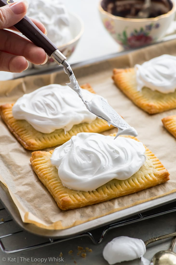 The s'mores pop tarts just after the marshmallow frosting has been swirled on top.