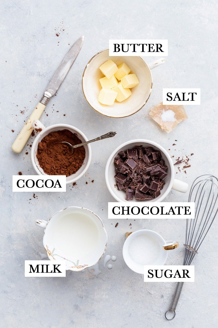 Making the chocolate fudge filling: the ingredients arranged on a light grey surface.