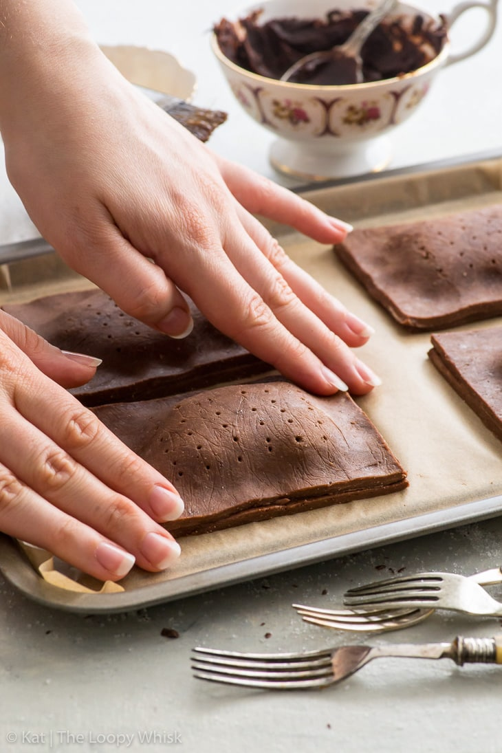 Making triple chocolate pop tarts: sealing the edges with wingers.