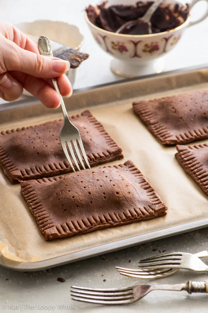 Making triple chocolate pop tarts: crimping the edges with a fork.