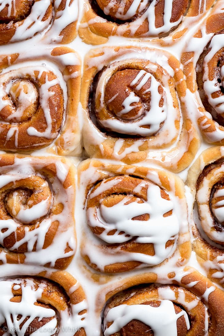 Overhead shot of vegan cinnamon rolls drizzled with the vegan frosting.