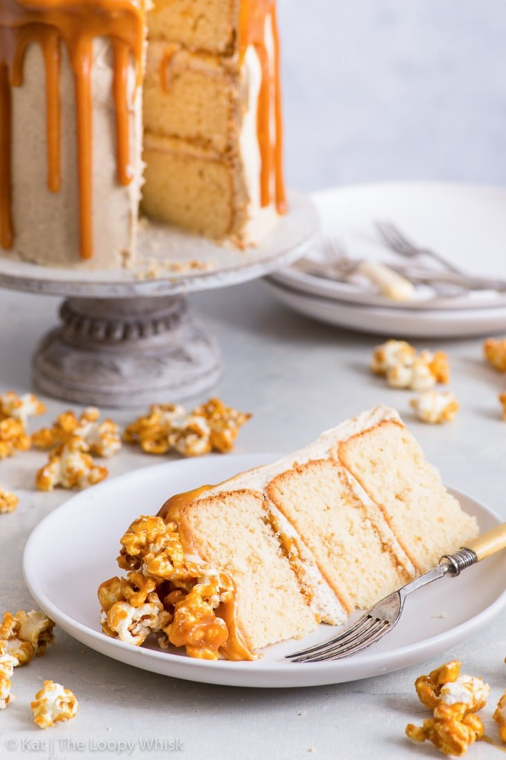 Close-up of a slice of the salted caramel popcorn cake.