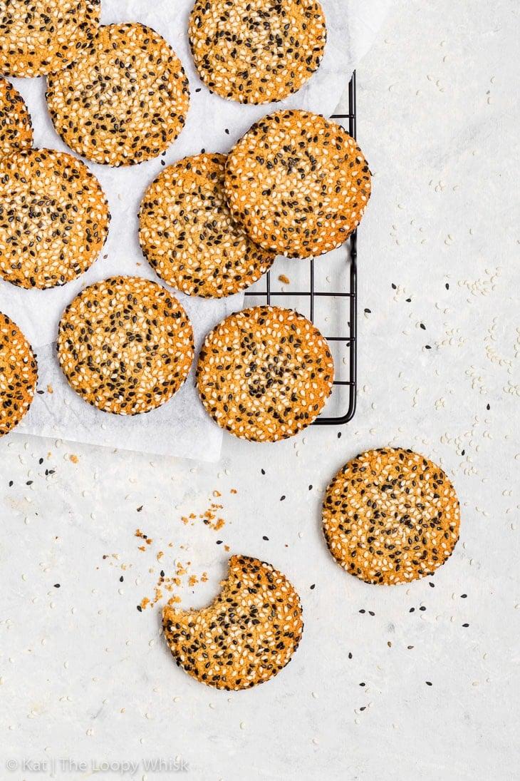 Overhead shot of vegan tahini cookies on a white background.