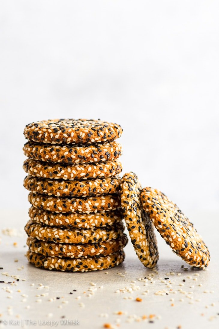 Stack of vegan tahini cookies on a white surface and background.