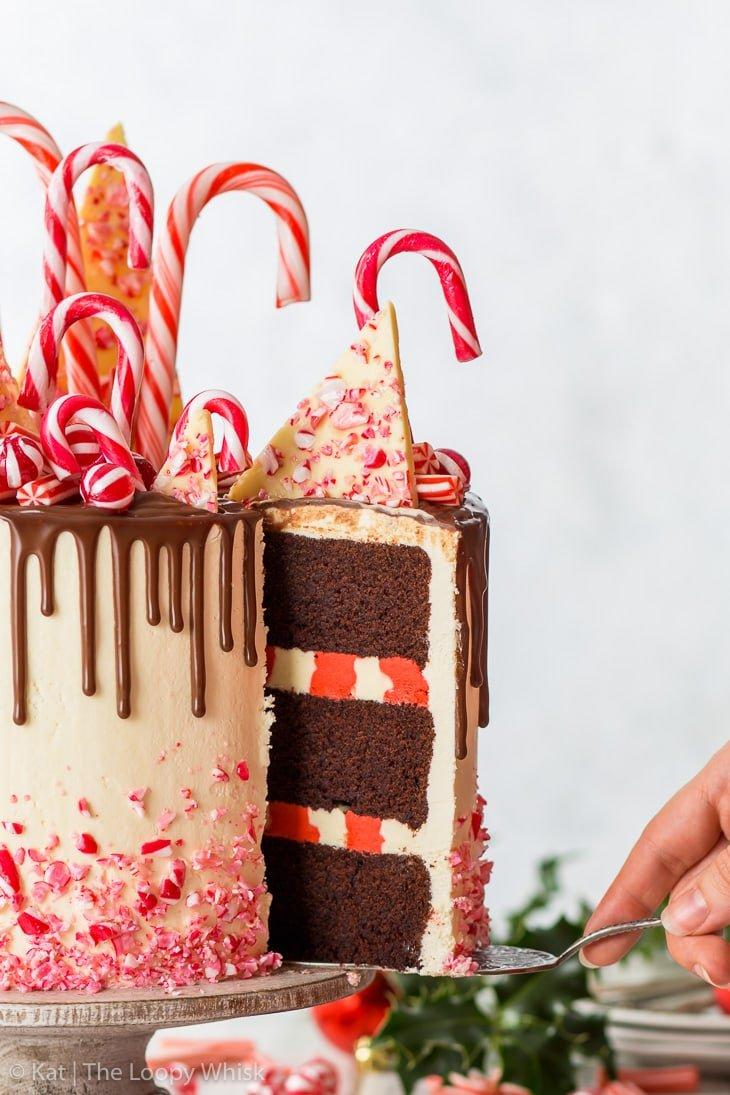 A piece of the candy cane cake being removed with an antique cake server.