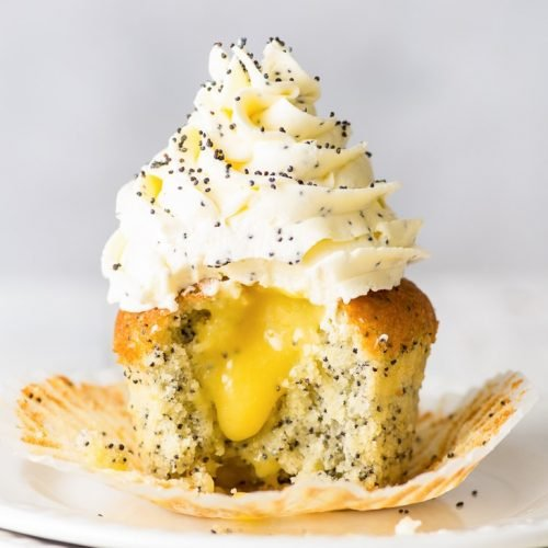 Lemon Poppy Seed Cupcakes (Gluten Free, Vegan Option) - These delicious gluten free cupcakes are basically sunshine in cupcake form. Each of the components (the soft and delicate cupcakes, the tangy lemon curd, the fluffy Swiss meringue buttercream) are amazing on their own. But together, they're simply to die for. Gluten free desserts. Lemon cupcakes. Easy dessert recipe. Easy cupcakes recipe. Lemon desserts. Homemade lemon curd recipe. Swiss meringue buttercream recipe. #glutenfree #cupcakes