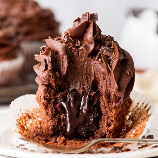Triple Chocolate Cupcakes (Gluten Free) - These triple chocolate cupcakes are ridiculously indulgent, easy to make and intensely chocolatey. With moist chocolate cupcakes, a luxurious chocolate fudge sauce and rich chocolate buttercream frosting, these cupcakes are without doubt one of the best chocolate desserts out there. Gluten free cupcakes. Easy cupcake recipes. Cupcake ideas. Cupcakes decoration. Gluten free desserts. Gluten free recipes. Chocolate frosting recipe. #chocolate #cupcakes