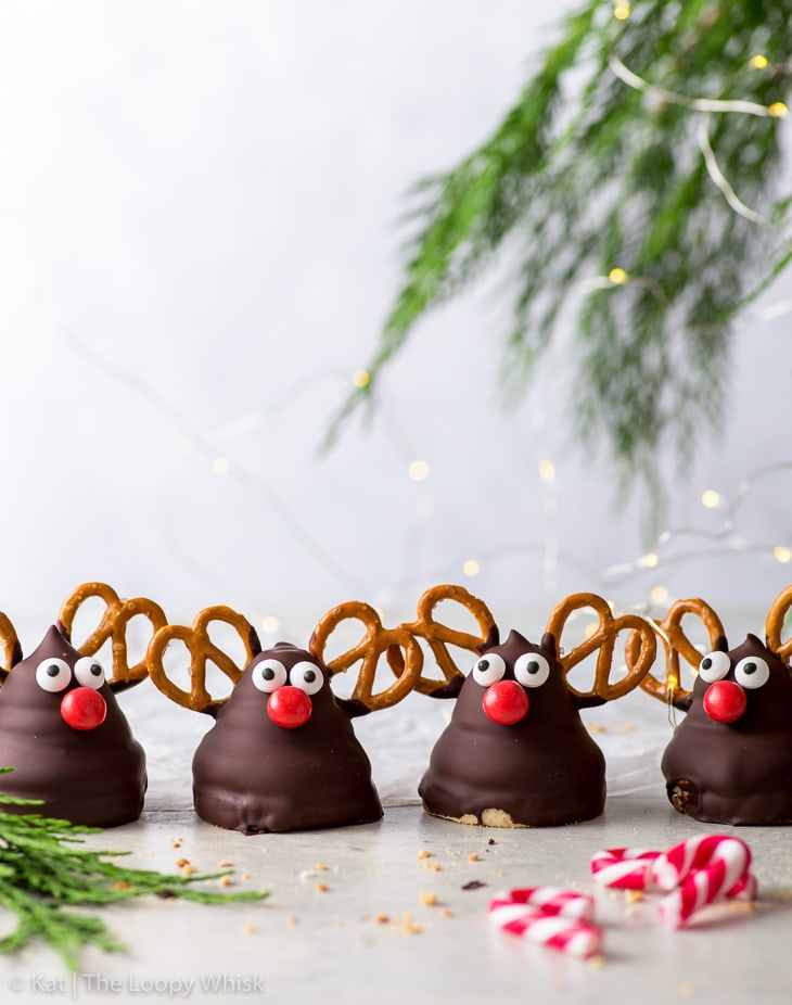 Four Rudolph marshmallow cookies in a row facing the camera.