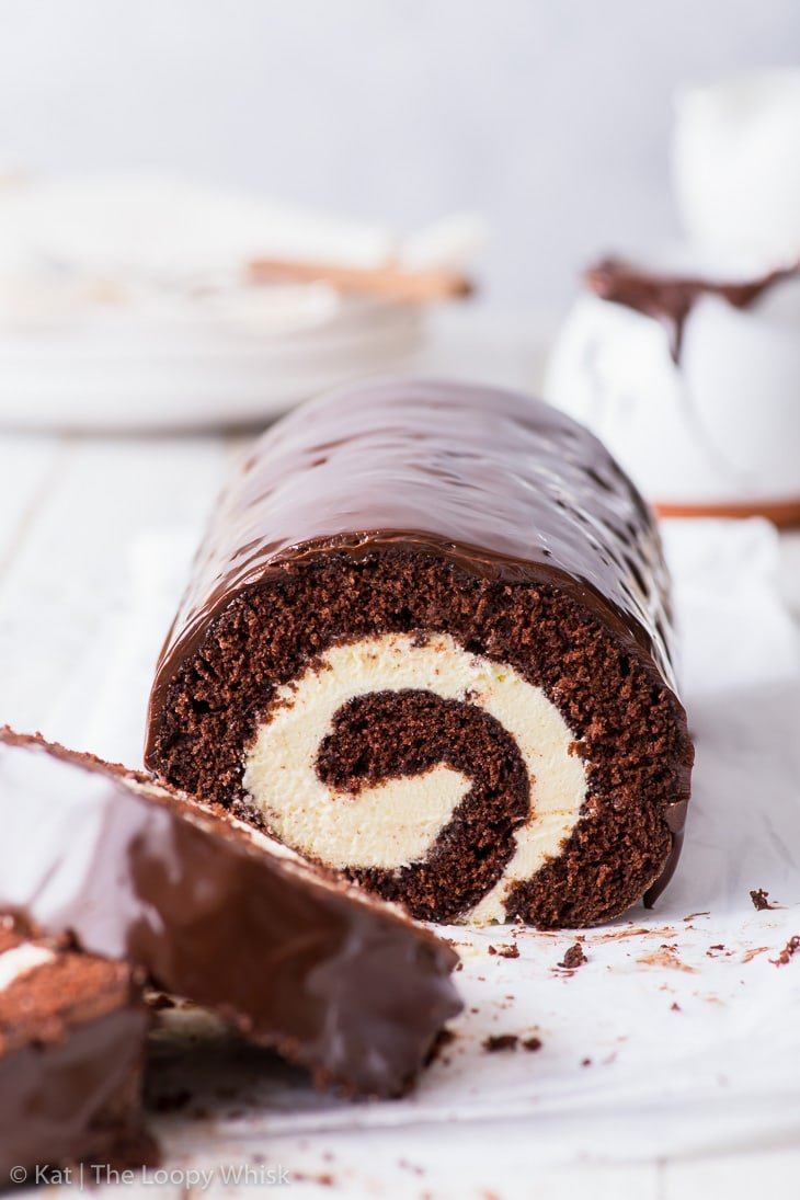 Head-on view of the chocolate Swiss roll, the swirl pattern clearly visible.