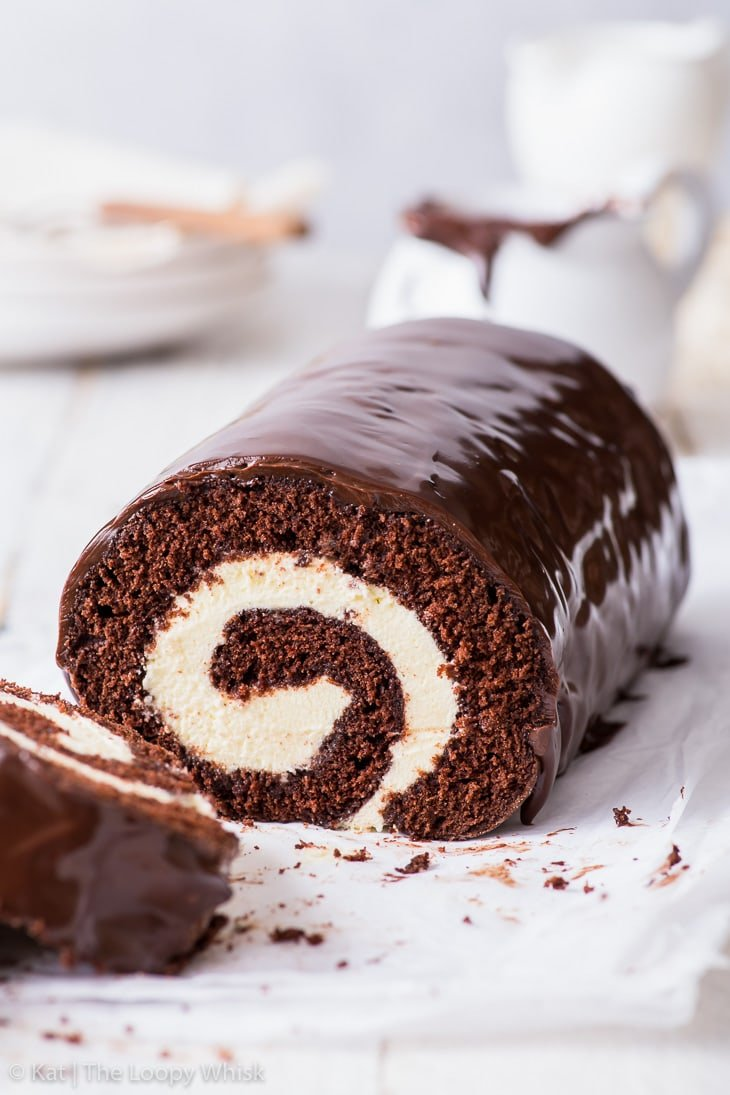 Side-on view of the chocolate Swiss roll, the swirl pattern clearly visible.