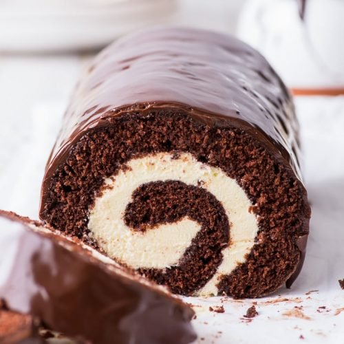 Chocolate Swiss Roll (Gluten Free) - A simple recipe for the most indulgent chocolate Swiss roll. With a moist and decadent gluten free chocolate sponge, a mascarpone whipped cream filling, and a super luscious chocolate ganache glaze. Every chocolate lover's dream come true. Swiss roll recipe. Roulade recipe. Cake roll recipe. Chocolate cake. Mascarpone frosting. Gluten free dessert recipe. Gluten free cake. Chocolate dessert recipes. Easy desserts. Easy cake recipe. #chocolate #cake