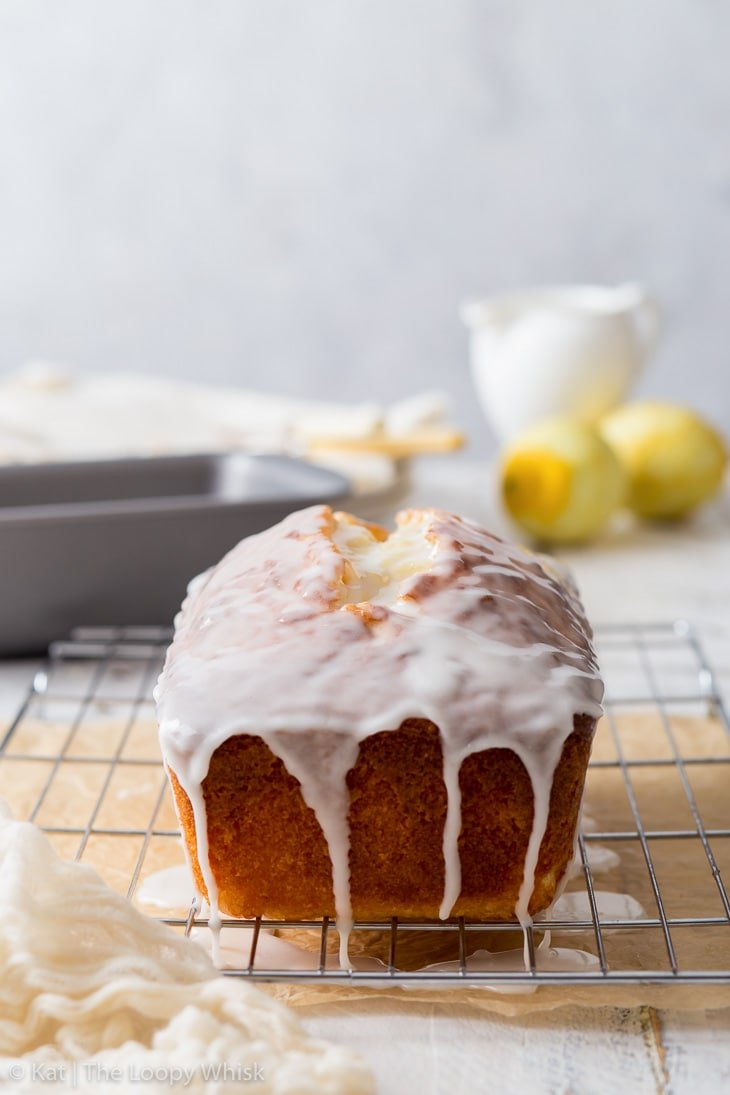 Making the lemon drizzle cake: the loaf cake covered with lemon icing.
