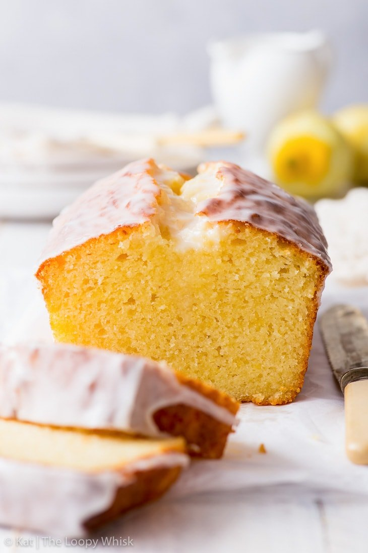Close-up of the lemon drizzle cake loaf, which has had a few slices cut already.