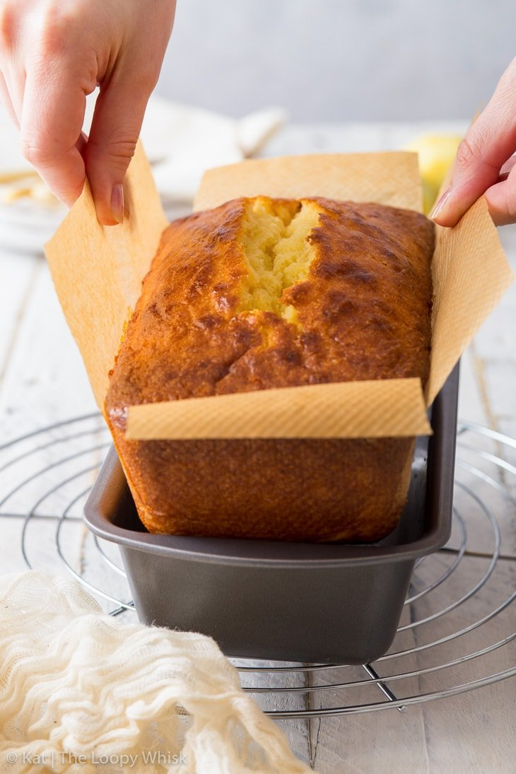 Making the lemon drizzle cake: lifting the baked lemon cake out of the loaf tin.