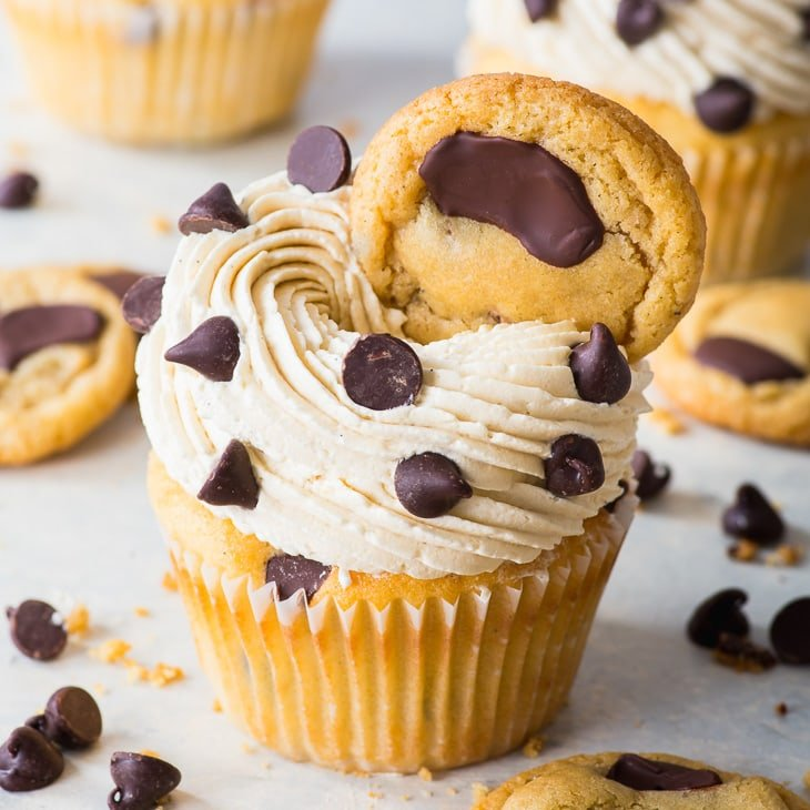 Chocolate Chip Cupcakes (Gluten Free) - Cute, delicious, and tasting like cookies – these chocolate chip cupcakes will blow your mind. They're moist, fluffy and chock-full of chocolate chips. And the brown sugar Swiss meringue buttercream tastes just like cookie dough. It truly doesn't get much better than this. Chocolate chip cookie cupcakes. Gluten free cupcakes. Gluten free desserts. Chocolate dessert recipes. Cupcake recipes. Swiss meringue buttercream recipe. #cupcakes #glutenfree