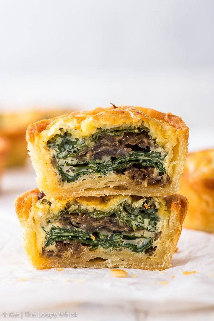 Spinach mini quiche, cut in half. The two halves are placed one on top of the other.
