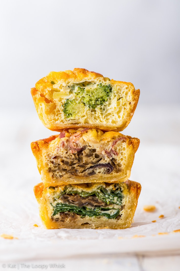 A small tower of three different mini quiche halves.