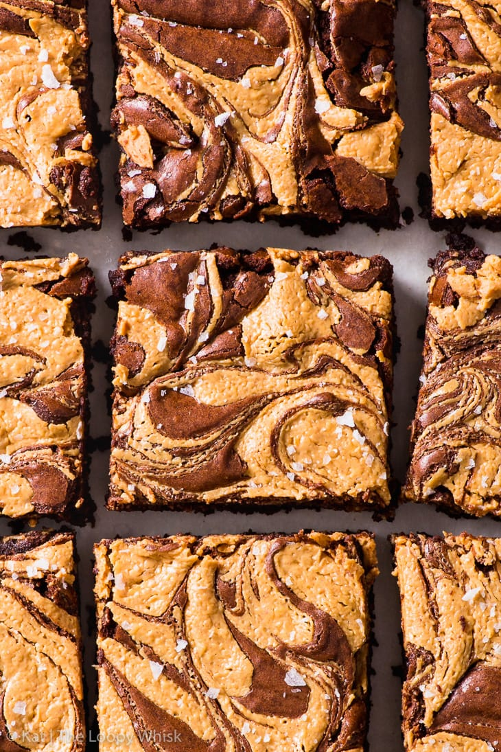 Overhead shot of the baked peanut butter swirl brownie, sprinkled with sea salt and cut into squares.