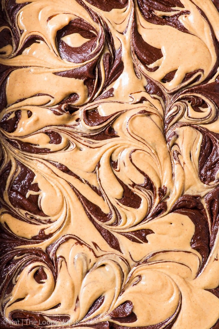 Overhead shot of brownie batter swirled through with peanut butter.