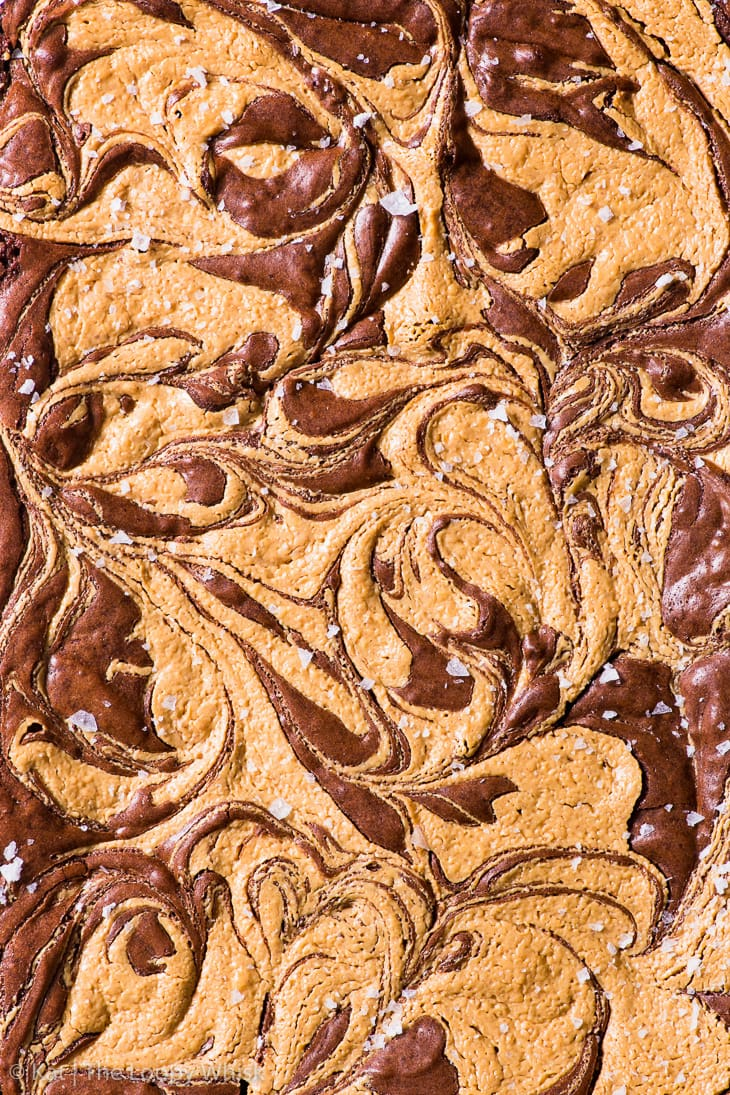 Overhead shot of the baked peanut butter swirl brownie, sprinkled with sea salt.