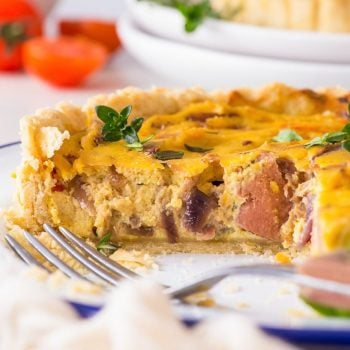 Easy Vegan Quiche with Jackfruit Confit [SPONSORED] - This vegan quiche is comfort food at its best. With a flaky, almost buttery olive oil pie crust and a delicious filling with caramelised onions, peppers and jackfruit – it will be the highlight of any lunch or dinner. Vegan meal prep. Vegan lunch recipes. Plant based recipes. Vegetarian quiche. Vegan meals. Vegan dinner. Healthy quiche recipes. Easy quiche recipe. Onion quiche. Lunch meal prep. Vegan food. #vegan #quiche