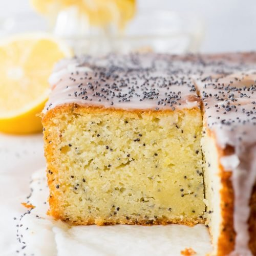 Simple Lemon Poppy Seed Cake (Gluten Free) - There's magic in every single slice of this lemon poppy seed cake. The magic of tangy lemon zest, a handful of poppy seeds, a cake that's equal parts moist and fluffy, and a refreshing lemon icing that ties it all together. Easy cake recipe. Lemon cake. Gluten free cake. Lemon drizzle cake. Lemon recipes. Lemon desserts. Gluten free recipes. Gluten free dessert. Cake ideas. Sheet cake recipes. #lemon #cake