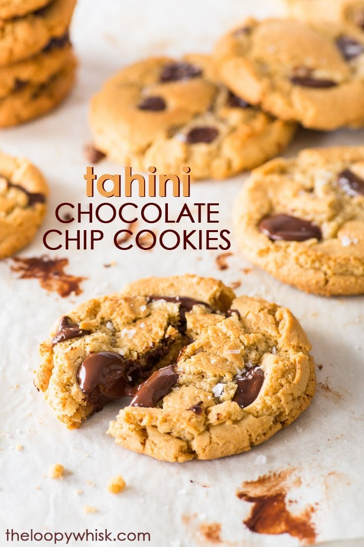 Tahini Chocolate Chip Cookies (Gluten Free) - Crispy round the edges, gooey in the middle, with earthy undertones of tahini: these AMAZING tahini chocolate chip cookies will simply blow your mind. They're super easy to make, and gluten free (without being at all obvious about it). Gluten free cookies. Tahini cookies. Gooey chocolate chip cookies. Gluten free desserts. Easy cookie recipes. Tahini recipes. #chocolatechipcookies #glutenfree